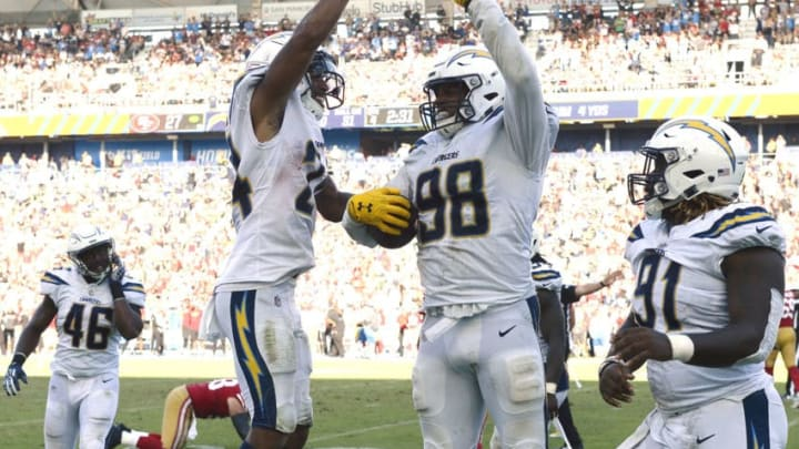 CARSON, CA - SEPTEMBER 30: Isaac Rochell #98 of the Los Angeles Chargers celebrate with teammate Trevor Williams #24 after intercepting quarterback C.J. Beathard #3 of the San Francisco 49ers throw in the closing minutes of the game at StubHub Center on September 30, 2018 in Carson, California. (Photo by Kevork Djansezian/Getty Images)