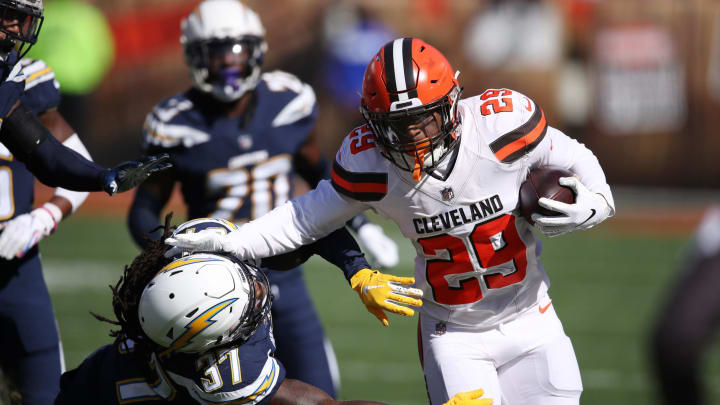 CLEVELAND, OH – OCTOBER 14: Duke Johnson #29 of the Cleveland Browns runs the ball defined by Jahleel Addae #37 of the Los Angeles Chargers in the first half at FirstEnergy Stadium on October 14, 2018 in Cleveland, Ohio. (Photo by Gregory Shamus/Getty Images)