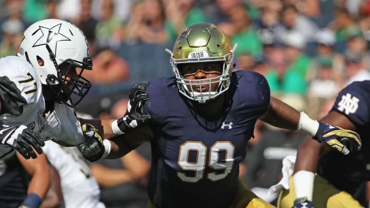 SOUTH BEND, IN – SEPTEMBER 15: Jerry Tillery #99 of the Notre Dame Fighting Irish rushes against Devin Cochran #77 of the Vanderbilt Commodores at Notre Dame Stadium on September 15, 2018, in South Bend, Indiana. Notre Dame defeated Vanderbilt 22-17. (Photo by Jonathan Daniel/Getty Images)