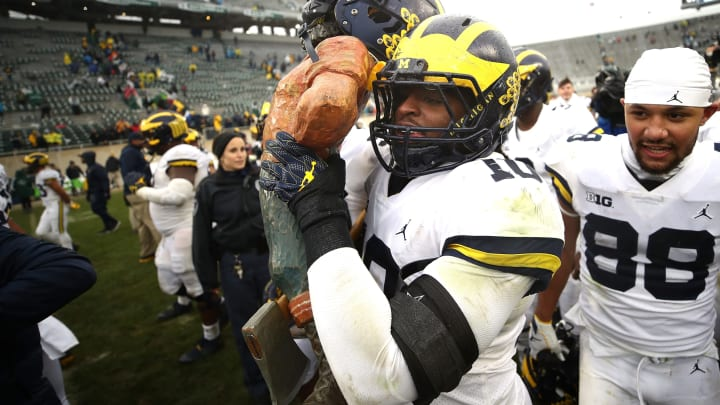 EAST LANSING, MI – OCTOBER 20: Devin Bush #10 of the Michigan Wolverines carries the Paul Bunyan trophy off the field after beating the Michigan State Spartans 21-7 at Spartan Stadium on October 20, 2018 in East Lansing, Michigan. (Photo by Gregory Shamus/Getty Images)