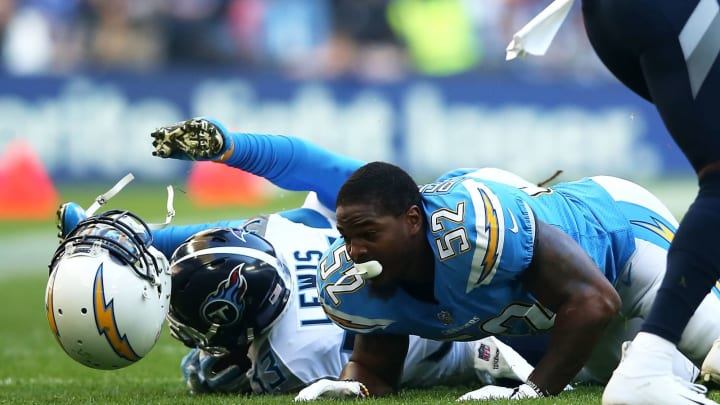 LONDON, ENGLAND – OCTOBER 21: Denzel Perryman #52 of the Los Angeles Chargers helmet comes off after he tackles Dion Lewis #33 of the Tennessee Titans during the NFL International Series game between Tennessee Titans and Los Angeles Chargers at Wembley Stadium on October 21, 2018, in London, England. (Photo by Jack Thomas/Getty Images)