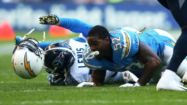 LONDON, ENGLAND - OCTOBER 21: Denzel Perryman #52 of the Los Angeles Chargers helmut comes off after he tackles Dion Lewis #33 of the Tennessee Titans during the NFL International Series game between Tennessee Titans and Los Angeles Chargers at Wembley Stadium on October 21, 2018 in London, England. (Photo by Jack Thomas/Getty Images)