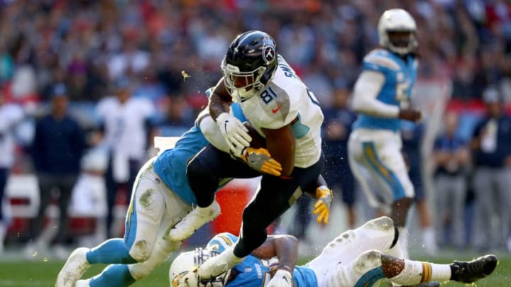 LONDON, ENGLAND - OCTOBER 21: Jonnu Smith of Tennessee Titans is tackled by Jatavis Brown of Los Angeles Chargers during the NFL International Series match between Tennessee Titans and Los Angeles Chargers at Wembley Stadium on October 21, 2018 in London, England. (Photo by Clive Rose/Getty Images)