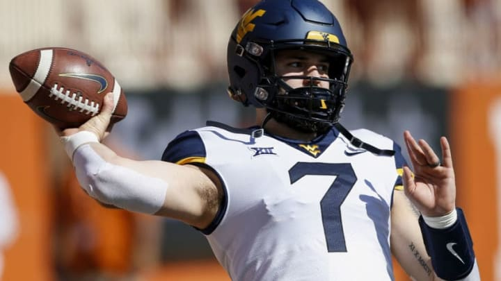 AUSTIN, TX - NOVEMBER 03: Will Grier #7 of the West Virginia Mountaineers warms up before the game against the Texas Longhorns at Darrell K Royal-Texas Memorial Stadium on November 3, 2018 in Austin, Texas. (Photo by Tim Warner/Getty Images)