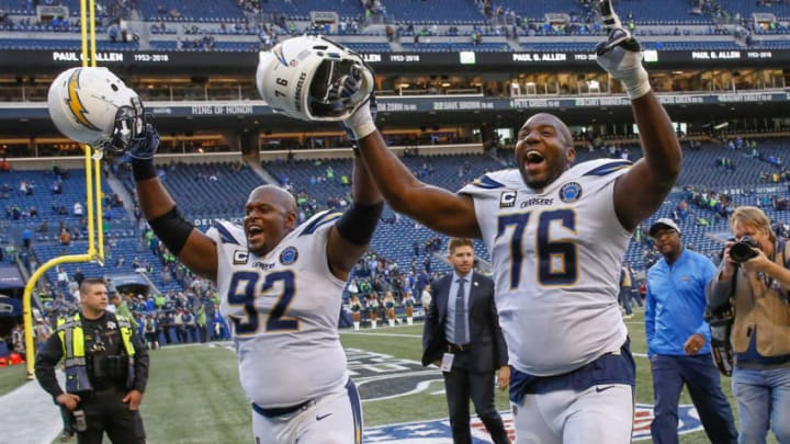 SEATTLE, WA - NOVEMBER 04: Brandon Mebane #92 and Russell Okung #76 of the Los Angeles Chargers head off the field following the game against the Seattle Seahawks at CenturyLink Field on November 4, 2018 in Seattle, Washington. (Photo by Otto Greule Jr/Getty Images)