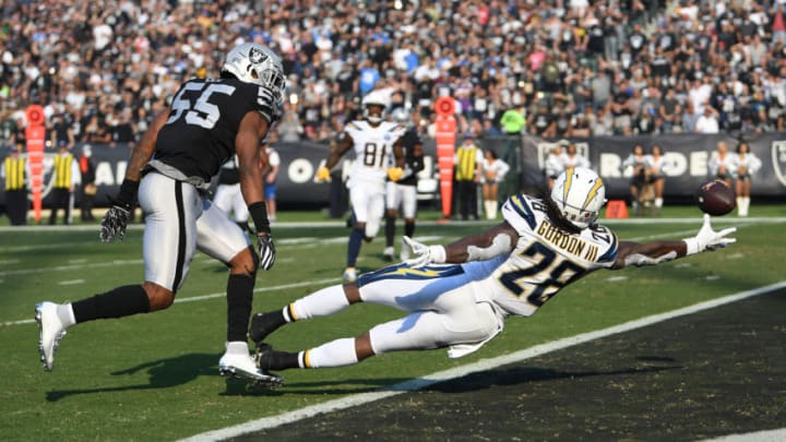 OAKLAND, CA - NOVEMBER 11: Melvin Gordon #28 of the Los Angeles Chargers is unable to make a catch in the end zone against the Oakland Raiders during their NFL game at Oakland-Alameda County Coliseum on November 11, 2018 in Oakland, California. (Photo by Thearon W. Henderson/Getty Images)