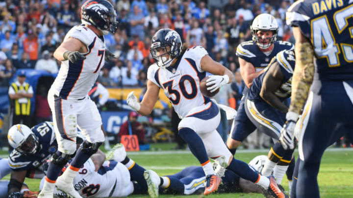 CARSON, CA - NOVEMBER 18: Running back Phillip Lindsay #30 of the Denver Broncos scores a touchdown to take a 20-19 lead in the fourth quarter against the Los Angeles Chargers at StubHub Center on November 18, 2018 in Carson, California. (Photo by Harry How/Getty Images)