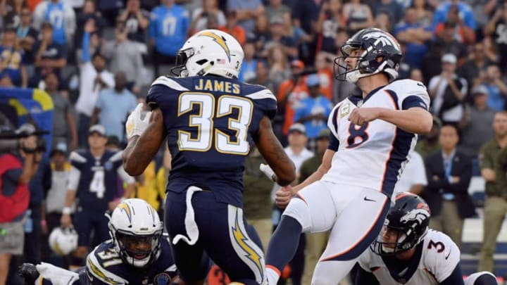 CARSON, CA - NOVEMBER 18: Brandon McManus #8 of the Denver Broncos watches his game winning field goal with Derwin James #33 of the Los Angeles Chargers for a 23-22 victory at StubHub Center on November 18, 2018 in Carson, California. (Photo by Harry How/Getty Images)