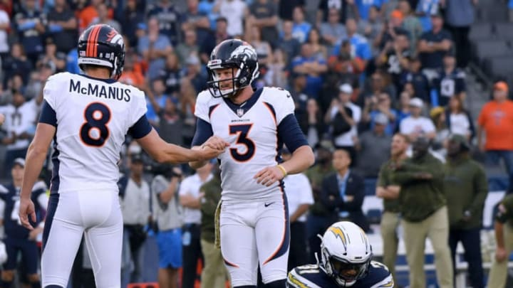 CARSON, CA - NOVEMBER 18: Brandon McManus #8 of the Denver Broncos celebrates his game winning field goal with Colby Wadman #3 in front of Derwin James #33 of the Los Angeles Chargers for a 23-22 victory at StubHub Center on November 18, 2018 in Carson, California. (Photo by Harry How/Getty Images)