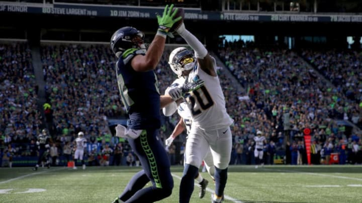 SEATTLE, WASHINGTON - NOVEMBER 04: Nick Vannett #81 of the Seattle Seahawks makes a catch past Desmond King II #20 of the Los Angeles Chargers in the first quarter against the Los Angeles Chargers at CenturyLink Field on November 04, 2018 in Seattle, Washington. (Photo by Abbie Parr/Getty Images)