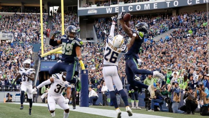 SEATTLE, WASHINGTON - NOVEMBER 04: Jaron Brown #18 of the Seattle Seahawks catches a pass for a touchdown past Casey Hayward Jr. #26 of the Los Angeles Chargers in the first quarter at CenturyLink Field on November 04, 2018 in Seattle, Washington. (Photo by Otto Greule Jr/Getty Images)