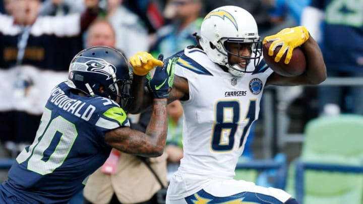 SEATTLE, WASHINGTON - NOVEMBER 04: Mike Williams #81 of the Los Angeles Chargers scores a touchdown past Bradley McDougald #30 of the Seattle Seahawks in the second quarter at CenturyLink Field on November 04, 2018 in Seattle, Washington. (Photo by Otto Greule Jr/Getty Images)