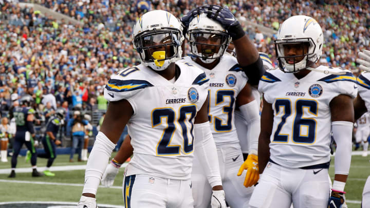 SEATTLE, WASHINGTON – NOVEMBER 04: Desmond King II #20 of the Los Angeles Chargers celebrates with teammates after scoring a touchdown from an interception in the fourth quarter against the Seattle Seahawks at CenturyLink Field on November 04, 2018 in Seattle, Washington. (Photo by Otto Greule Jr/Getty Images)