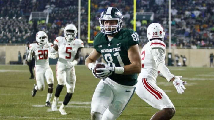 EAST LANSING, MI - NOVEMBER 24: Tight end Matt Sokol #81 of the Michigan State Spartans scores against the Rutgers Scarlet Knights on a touchdown reception during the second quarter at Spartan Stadium on November 24, 2018 in East Lansing, Michigan. (Photo by Duane Burleson/Getty Images)