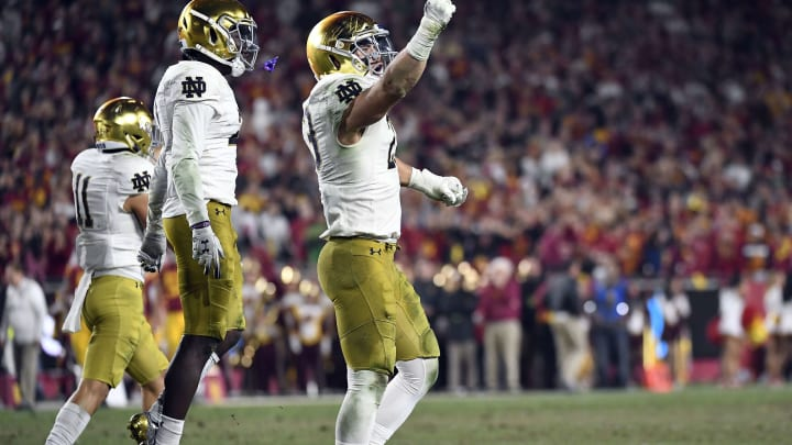 LOS ANGELES, CA – NOVEMBER 24: Drue Tranquill #23 of the Notre Dame Fighting Irish celebrates after recovering the fumble by Amon-Ra St. Brown #8 of the USC Trojans during the first half at Los Angeles Memorial Coliseum on November 24, 2018 in Los Angeles, California. (Photo by Kevork Djansezian/Getty Images)