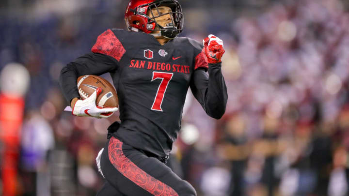 SAN DIEGO, CA - NOVEMBER 24: Fred Trevillion #7 of the San Diego State Aztecs catches the ball scoring a 69 yard touchdown scoring in the first half against the Hawaii Rainbow Warriors at SDCCU Stadium on November 24, 2018 in San Diego, California. (Photo by Kent Horner/Getty Images)