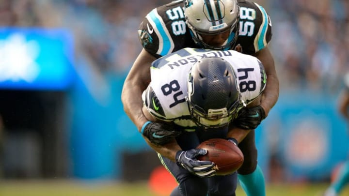 CHARLOTTE, NC - NOVEMBER 25: Ed Dickson #84 of the Seattle Seahawks catches a pass against Thomas Davis #58 of the Carolina Panthers in the third quarter during their game at Bank of America Stadium on November 25, 2018 in Charlotte, North Carolina. (Photo by Grant Halverson/Getty Images)