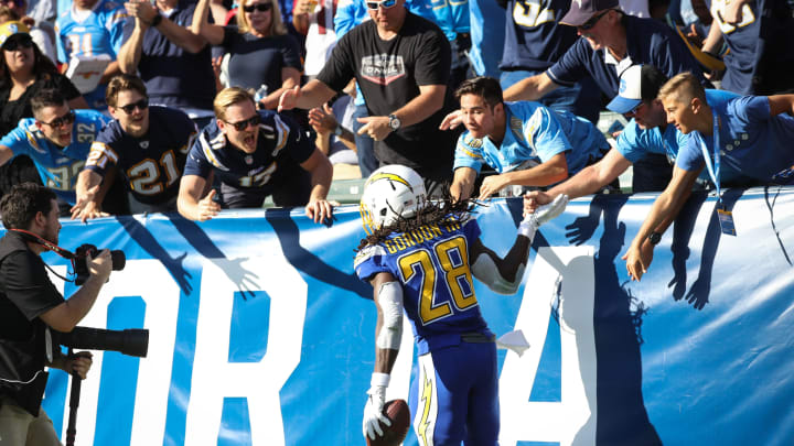 CARSON, CA – NOVEMBER 25: Running back Melvin Gordon #28 of the Los Angeles Chargers celebrates with fans after scoring a touchdown in the second quarter against the Arizona Cardinals at StubHub Center on November 25, 2018 in Carson, California. (Photo by Sean M. Haffey/Getty Images)