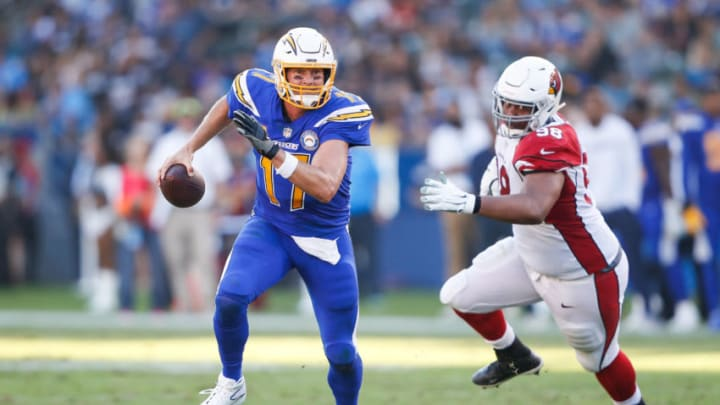 CARSON, CA - NOVEMBER 25: Quarterback Philip Rivers #17 of the Los Angeles Chargers is forced out of the pocket by defensive tackle Corey Peters #98 of the Arizona Cardinals in the third quarter at StubHub Center on November 25, 2018 in Carson, California. (Photo by Sean M. Haffey/Getty Images)