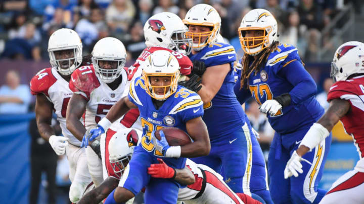 CARSON, CA - NOVEMBER 25: Running back Justin Jackson #32 of the Los Angeles Chargers is tackled by defensive back Tre Boston #33 of the Arizona Cardinals in the third quarter at StubHub Center on November 25, 2018 in Carson, California. (Photo by Harry How/Getty Images)