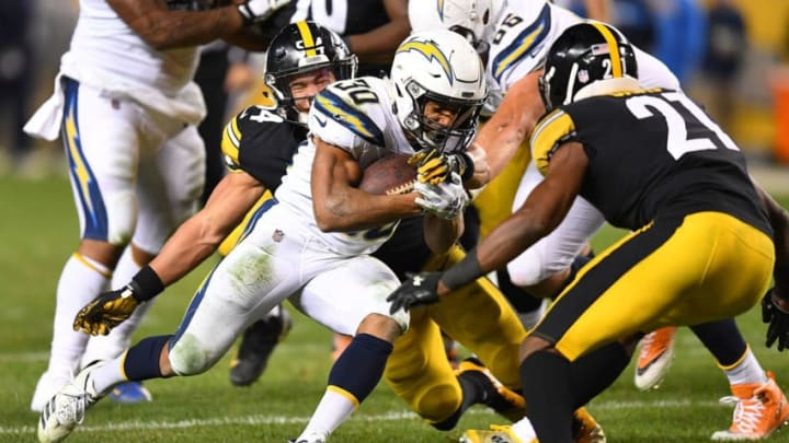 PITTSBURGH, PA - DECEMBER 02: Austin Ekeler #30 of the Los Angeles Chargers rushes the ball against Sean Davis #21 of the Pittsburgh Steelers in the second half during the game at Heinz Field on December 2, 2018 in Pittsburgh, Pennsylvania. (Photo by Joe Sargent/Getty Images)