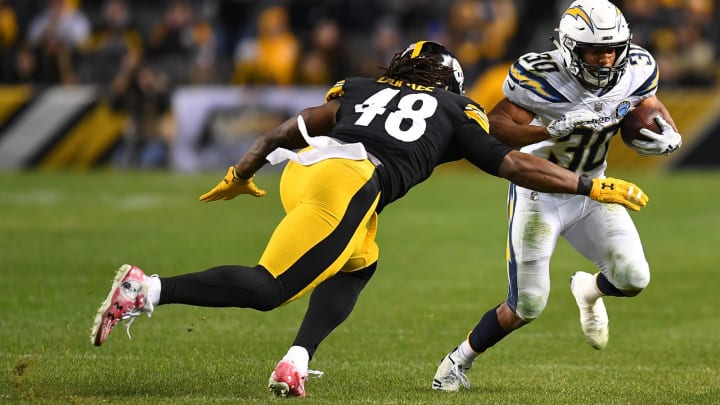 PITTSBURGH, PA – DECEMBER 02: Austin Ekeler #30 of the Los Angeles Chargers rushes the ball against Bud Dupree #48 of the Pittsburgh Steelers in the second half during the game at Heinz Field on December 2, 2018 in Pittsburgh, Pennsylvania. (Photo by Joe Sargent/Getty Images)