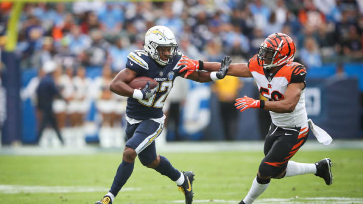 CARSON, CA - DECEMBER 09: Running back Justin Jackson #32 of the Los Angeles Chargers makes a play in front of middle linebacker Hardy Nickerson #56 of the Cincinnati Bengals for a first down in the first quarter at StubHub Center on December 9, 2018 in Carson, California. (Photo by Sean M. Haffey/Getty Images)
