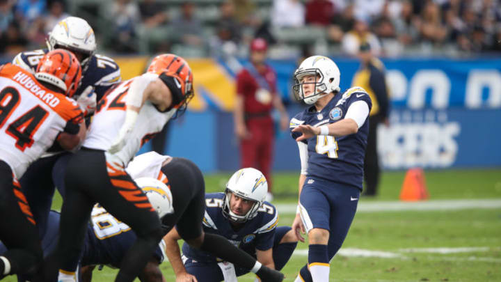 CARSON, CA - DECEMBER 09: Kicker Mike Badgley #4 of the Los Angeles Chargers and punter Donnie Jones #5 watch for the field goal in the second quarter against the Cincinnati Bengals at StubHub Center on December 9, 2018 in Carson, California. (Photo by Sean M. Haffey/Getty Images)