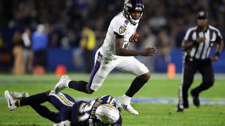 CARSON, CA - DECEMBER 22: Lamar Jackson #8 of the Baltimore Ravens runs past the defense of Adrian Phillips #31 of the Los Angeles Chargers during the first half of a game at StubHub Center on December 22, 2018 in Carson, California. (Photo by Sean M. Haffey/Getty Images)