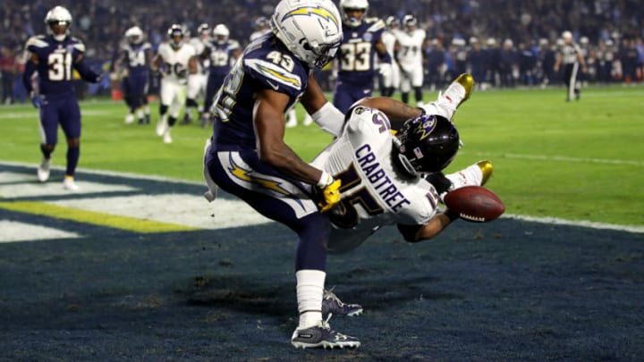CARSON, CA - DECEMBER 22: Michael Davis #43 of the Los Angeles Chargers breaks up a pass play intended for Michael Crabtree #15 of the Baltimore Ravens during the first half of a game at StubHub Center on December 22, 2018 in Carson, California. (Photo by Sean M. Haffey/Getty Images)