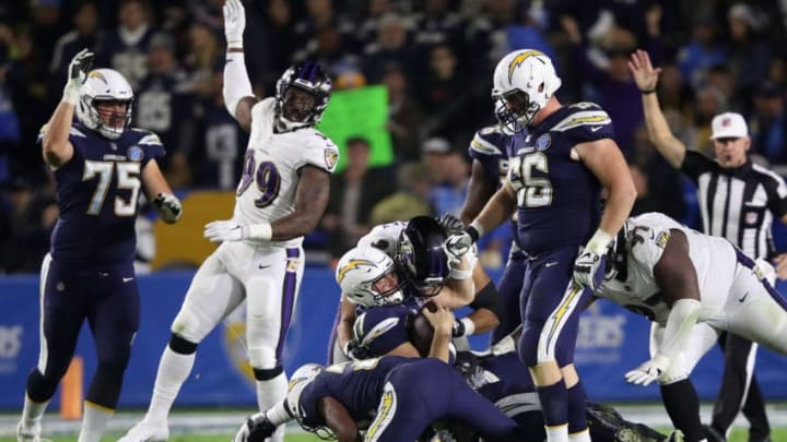 CARSON, CA - DECEMBER 22: Chris Wormley #93 of the Baltimore Ravens sacks Philip Rivers #17 as Dan Feeney #66 and Michael Schofield #75 of the Los Angeles Chargers look on during the second half of a game at StubHub Center on December 22, 2018 in Carson, California. (Photo by Sean M. Haffey/Getty Images)
