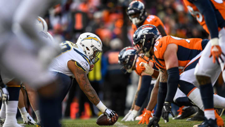 DENVER, CO - DECEMBER 30: Center Mike Pouncey #53 of the Los Angeles Chargers lines up on offense against the Denver Broncos in the first half during a game at Broncos Stadium at Mile High on December 30, 2018 in Denver, Colorado. (Photo by Dustin Bradford/Getty Images)