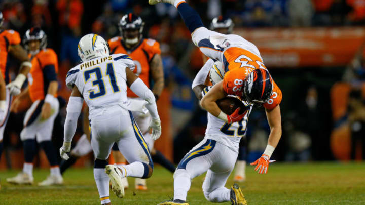 DENVER, CO - DECEMBER 30: Tight end Matt LaCosse #83 of the Denver Broncos is upended by defensive back Desmond King #20 of the Los Angeles Chargers in the fourth quarter of a game at Broncos Stadium at Mile High on December 30, 2018 in Denver, Colorado. (Photo by Justin Edmonds/Getty Images)