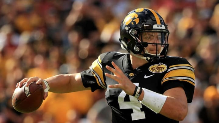 TAMPA, FL - JANUARY 01: Nate Stanley #4 of the Iowa Hawkeyes passes during the 2019 Outback Bowl against the Mississippi State Bulldogs at Raymond James Stadium on January 1, 2019 in Tampa, Florida. (Photo by Mike Ehrmann/Getty Images)