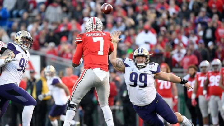 PASADENA, CA - JANUARY 01: Greg Gaines #99 of the Washington Huskies attempts to intercept a pass by Dwayne Haskins #7 of the Ohio State Buckeyes during the second half in the Rose Bowl Game presented by Northwestern Mutual at the Rose Bowl on January 1, 2019 in Pasadena, California. (Photo by Kevork Djansezian/Getty Images)