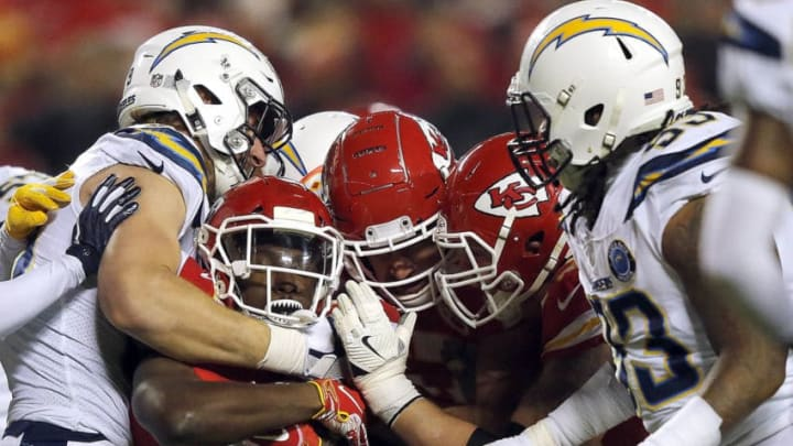 KANSAS CITY, MISSOURI - DECEMBER 13: Running back Darrel Williams #31 of the Kansas City Chiefs carries the ball during the game against the Los Angeles Chargers at Arrowhead Stadium on December 13, 2018 in Kansas City, Missouri. (Photo by David Eulitt/Getty Images)