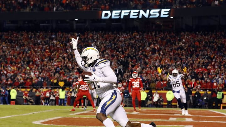 KANSAS CITY, MISSOURI – DECEMBER 13: Wide receiver Mike Williams #81 of the Los Angeles Chargers celebrates after catching the two-point conversion with 4 seconds remaining in the game to put the Chargers up 29-28 on the Kansas City Chiefs at Arrowhead Stadium on December 13, 2018, in Kansas City, Missouri. (Photo by David Eulitt/Getty Images)