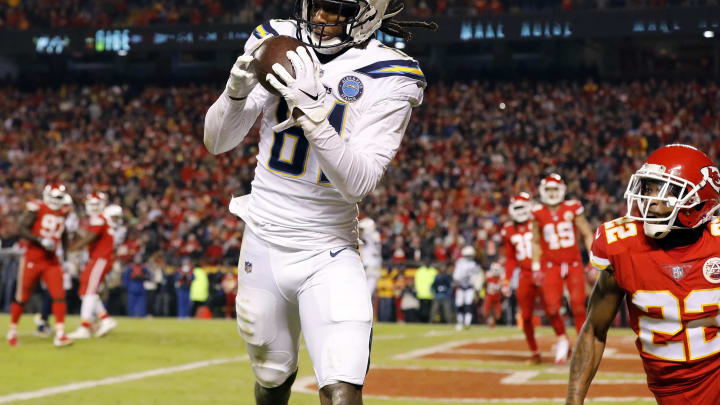 KANSAS CITY, MISSOURI – DECEMBER 13: Wide receiver Mike Williams #81 of the Los Angeles Chargers catches a pass for a touchdown as defensive back Orlando Scandrick #22 of the Kansas City Chiefs defends during the 4th quarter of the game at Arrowhead Stadium on December 13, 2018 in Kansas City, Missouri. (Photo by David Eulitt/Getty Images)