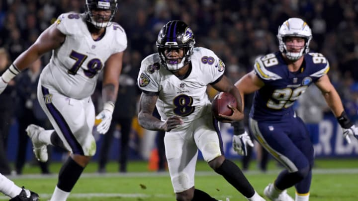 CARSON, CALIFORNIA - DECEMBER 22: Lamar Jackson #8 of the Baltimore Ravens scrambles short of a first down in front of Joey Bosa #99 of the Los Angeles Chargers and Orlando Brown #78 during the second quarter at StubHub Center on December 22, 2018 in Carson, California. (Photo by Harry How/Getty Images)