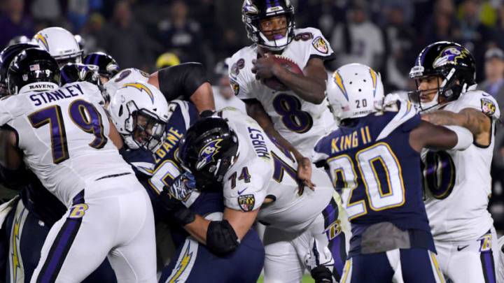 CARSON, CALIFORNIA - DECEMBER 22: Lamar Jackson #8 of the Baltimore Ravens extends the ball on his keeper for a first down during the first quarter against the Los Angeles Chargers at StubHub Center on December 22, 2018 in Carson, California. (Photo by Harry How/Getty Images)