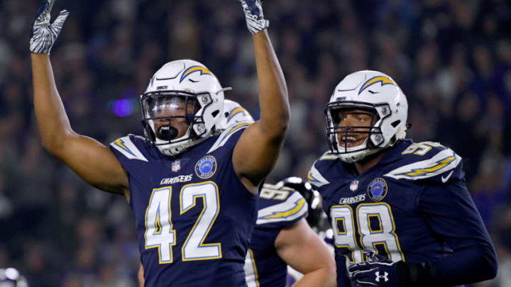 CARSON, CALIFORNIA - DECEMBER 22: Uchenna Nwosu #42 of the Los Angeles Chargers celebrates his stop of Lamar Jackson #8 on third down with Isaac Rochell #98 during the first quarter at StubHub Center on December 22, 2018 in Carson, California. (Photo by Harry How/Getty Images)