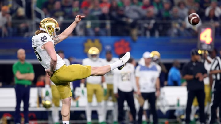 ARLINGTON, TEXAS – DECEMBER 29: Tyler Newsome #85 of the Notre Dame Fighting Irish punts in the first quarter against the Clemson Tigers during the College Football Playoff Semifinal Goodyear Cotton Bowl Classic at AT&T Stadium on December 29, 2018, in Arlington, Texas. (Photo by Tom Pennington/Getty Images)