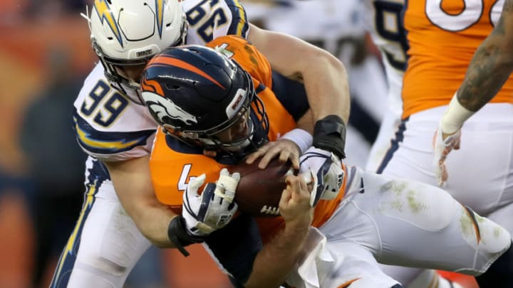 DENVER, COLORADO - DECEMBER 30: Joey Bosa #99 of the Los Angeles Chargers sacks Case Keenum #4 of the Denver Broncos at Broncos Stadium at Mile High on December 30, 2018 in Denver, Colorado. (Photo by Matthew Stockman/Getty Images)
