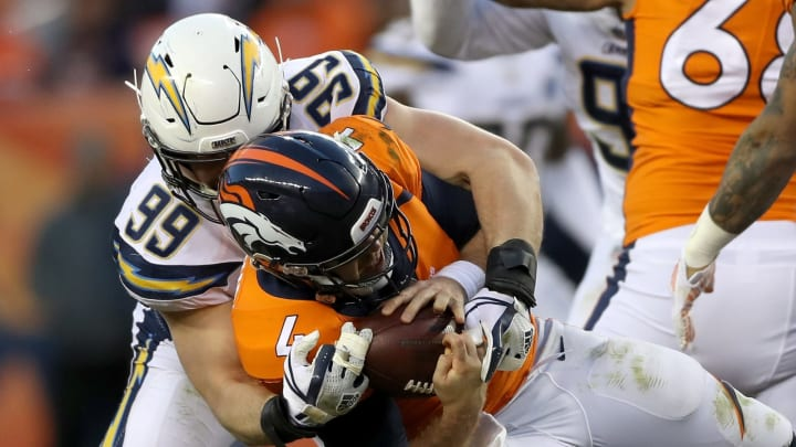 DENVER, COLORADO – DECEMBER 30: Joey Bosa #99 of the Los Angeles Chargers sacks Case Keenum #4 of the Denver Broncos at Broncos Stadium at Mile High on December 30, 2018, in Denver, Colorado. (Photo by Matthew Stockman/Getty Images)