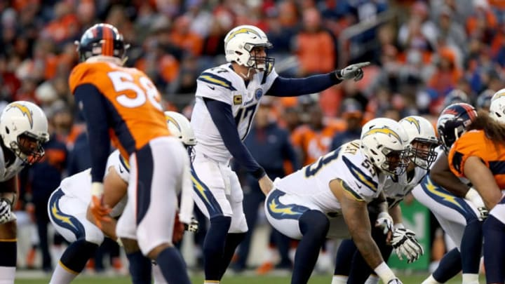 DENVER, COLORADO - DECEMBER 30: Quarterback Philip Rivers #17 of the Los Angeles Chargers plays the Denver Broncos at Broncos Stadium at Mile High on December 30, 2018 in Denver, Colorado. (Photo by Matthew Stockman/Getty Images)