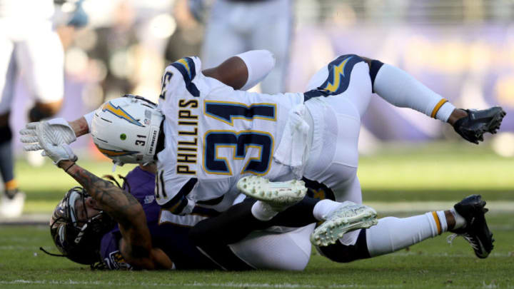 BALTIMORE, MARYLAND - JANUARY 06: Adrian Phillips #31 of the Los Angeles Chargers intercepts a pass by Lamar Jackson #8 of the Baltimore Ravens during the second quarter in the AFC Wild Card Playoff game at M&T Bank Stadium on January 06, 2019 in Baltimore, Maryland. (Photo by Patrick Smith/Getty Images)