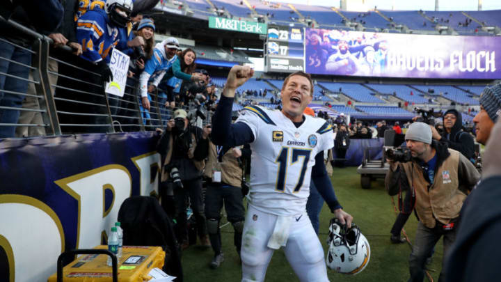BALTIMORE, MARYLAND - JANUARY 06: Philip Rivers #17 of the Los Angeles Chargers celebrates after defeating the Baltimore Ravens after the AFC Wild Card Playoff game at M&T Bank Stadium on January 06, 2019 in Baltimore, Maryland. The Chargers defeated the Ravens with a score of 23 to 17. (Photo by Rob Carr/Getty Images) (Photo by Rob Carr/Getty Images)