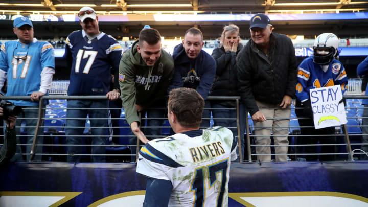 BALTIMORE, MARYLAND – JANUARY 06: Philip Rivers #17 of the Los Angeles Chargers celebrates with fans after defeating the Baltimore Ravens after the AFC Wild Card Playoff game at M&T Bank Stadium on January 06, 2019 in Baltimore, Maryland. The Chargers defeated the Ravens with a score of 23 to 17.(Photo by Rob Carr/Getty Images)