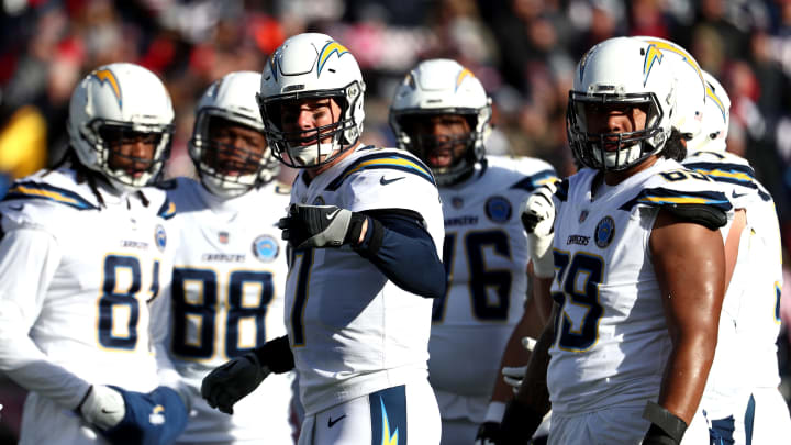 FOXBOROUGH, MASSACHUSETTS – JANUARY 13: Philip Rivers #17 of the Los Angeles Chargers reacts in the huddle during the second quarter in the AFC Divisional Playoff Game against the New England Patriots at Gillette Stadium on January 13, 2019 in Foxborough, Massachusetts. (Photo by Al Bello/Getty Images)