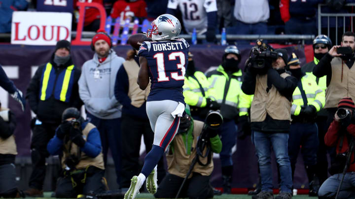 FOXBOROUGH, MASSACHUSETTS – JANUARY 13: Phillip Dorsett #13 of the New England Patriots catches a touchdown pass during the second quarter in the AFC Divisional Playoff Game against the Los Angeles Chargers at Gillette Stadium on January 13, 2019 in Foxborough, Massachusetts. (Photo by Al Bello/Getty Images)